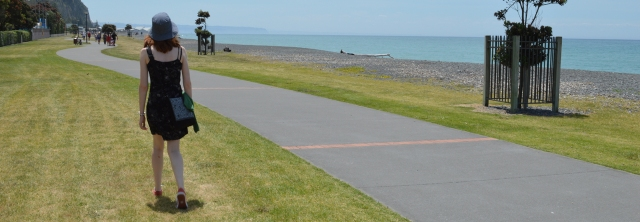 The author stands next to a path by the sea. The path continues off into the distance.